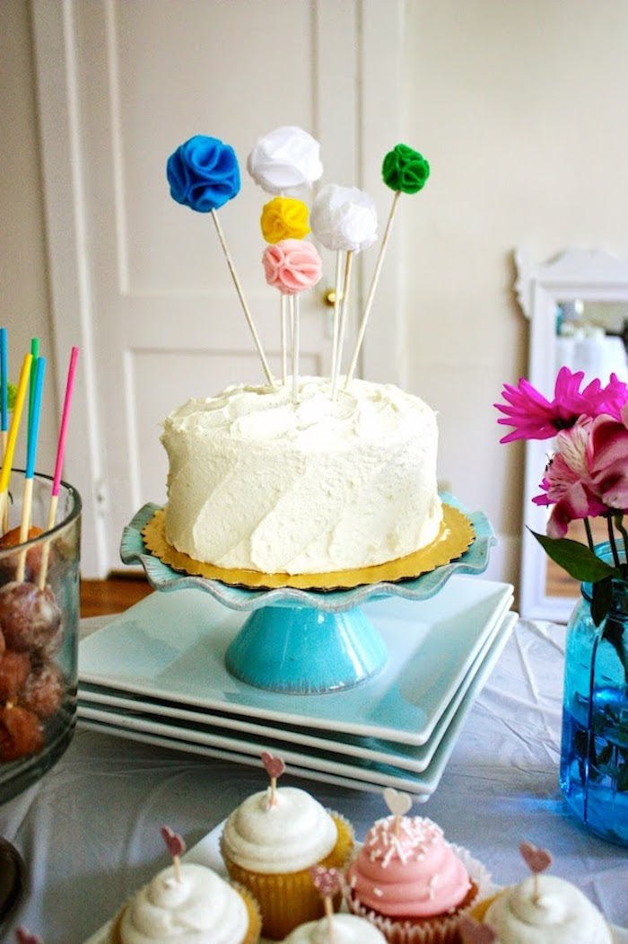 Felt pompoms work like colored dots on an all white cake.