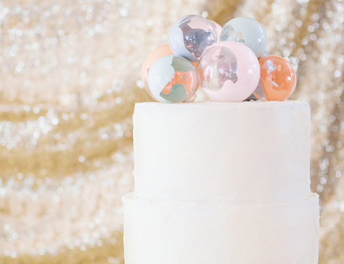 Glass balls make the cake look super different.