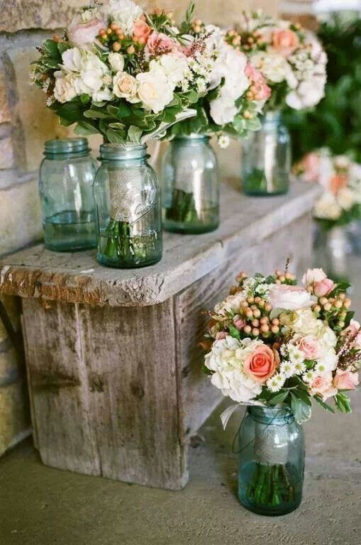 Arrangements with glass jars.