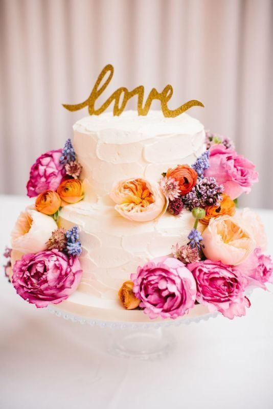 A romantic cake, decorated with flowers.