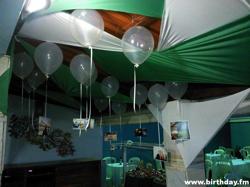 Party decorated with fabrics and balloons with photos.