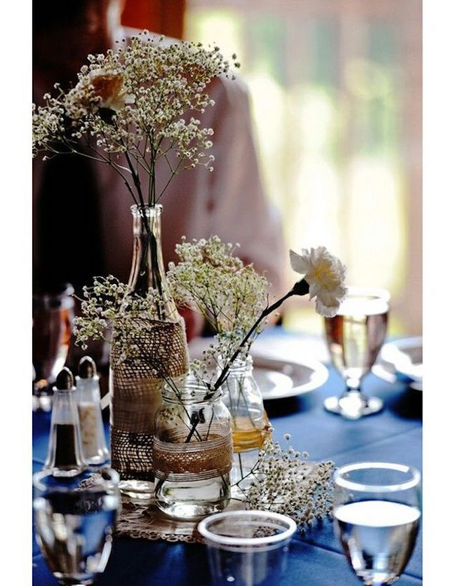 Table centerpiece made with bottles and glass jars