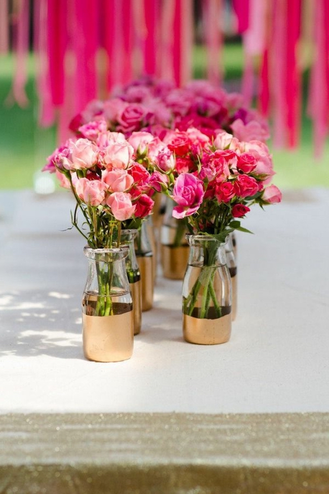 Use lots of flower arrangements to decorate the birthday table