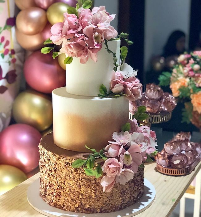 The Rose Gold cake is on the rise and can be part of the decoration