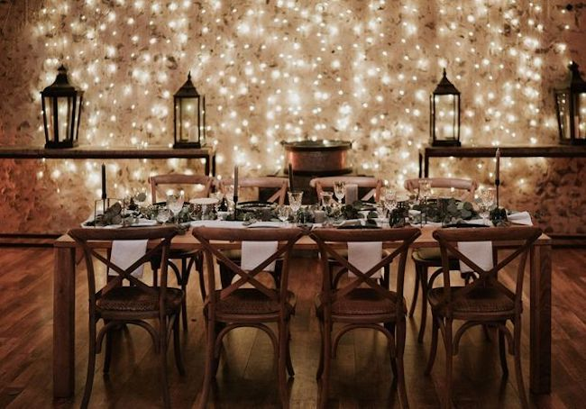 Build a cozy decor with rustic furniture and lights