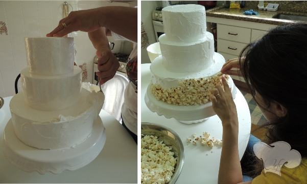 Apply the icing on the styrofoam and add the popcorn.