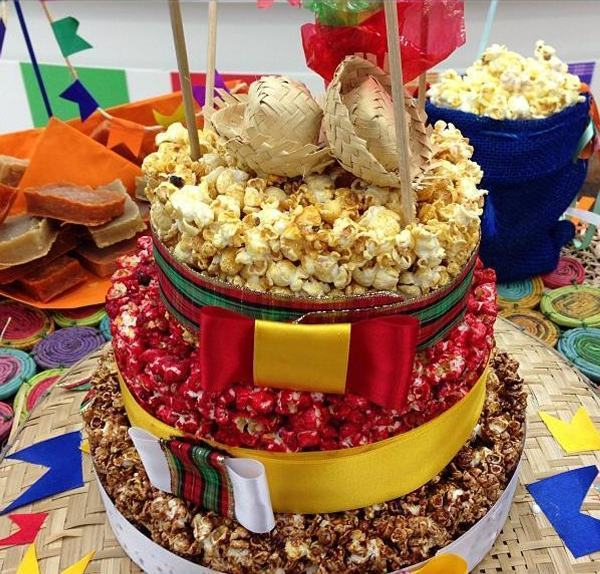 Two-story popcorn cake and mini straw hats on top