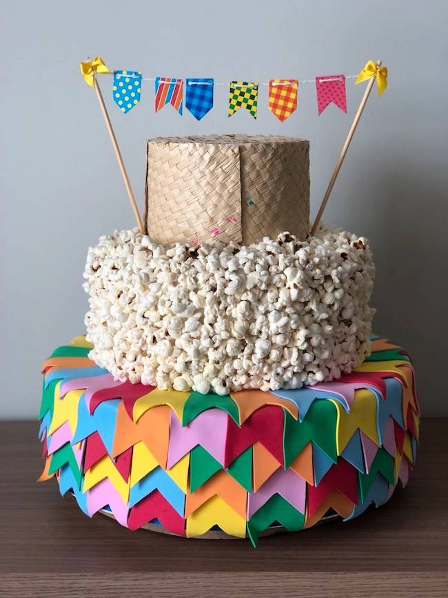 Fake cake with a floor of flags, another of popcorn and another of straw.