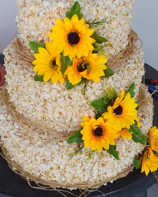 Use sunflowers to enhance the look of the cake