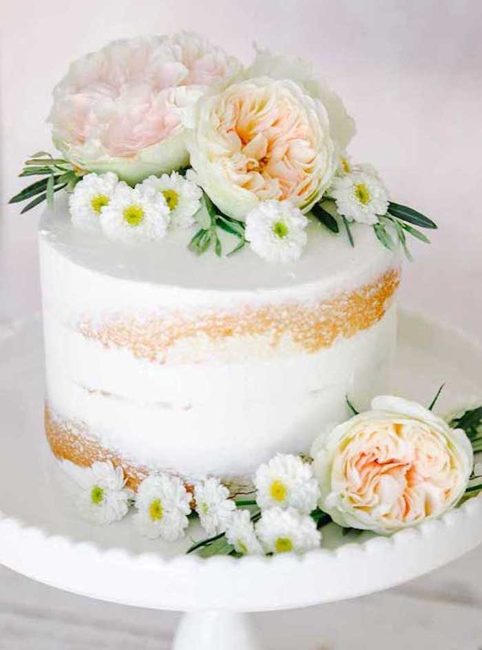 A small spatulated cake decorated with fresh flowers