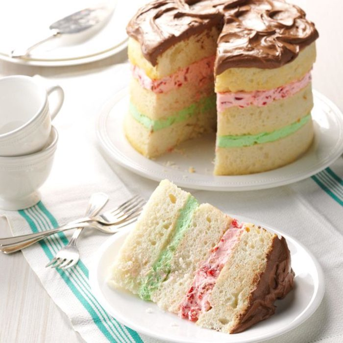 The cake combines layers of filling in green and pink