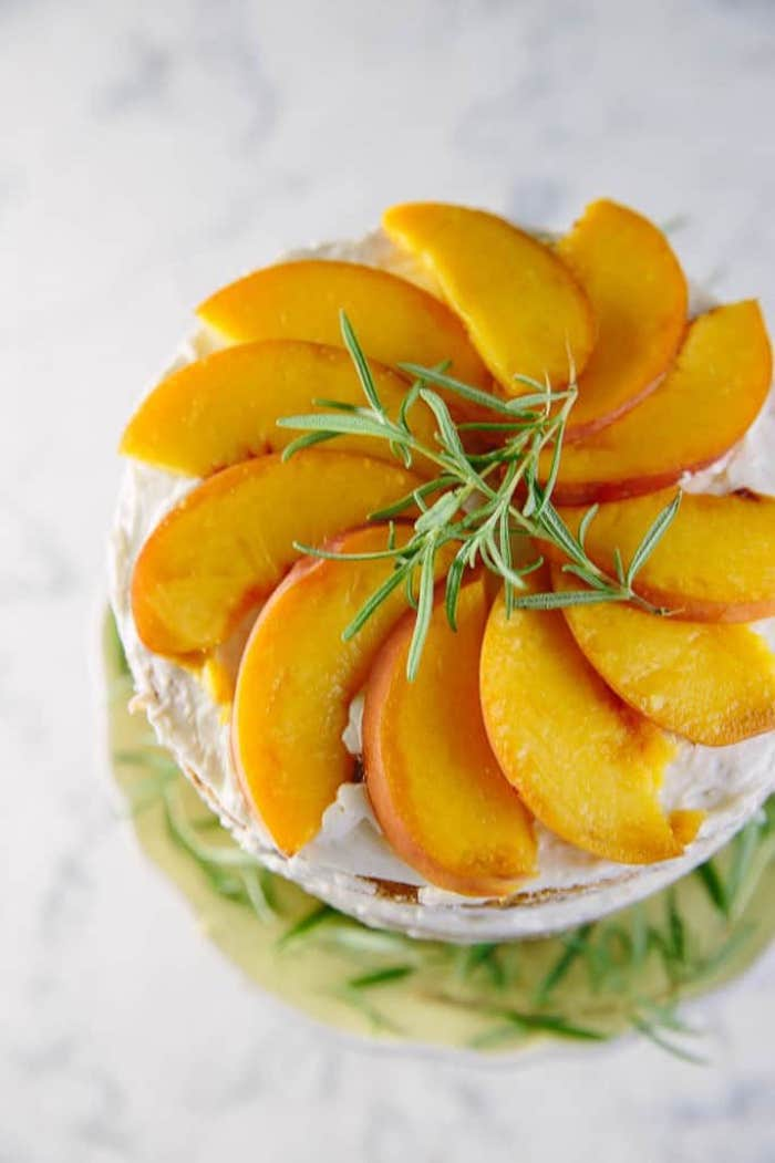 Top decorated with rosemary branch and peach slices