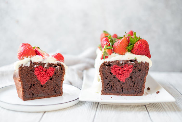 The chocolate cake holds a red heart inside