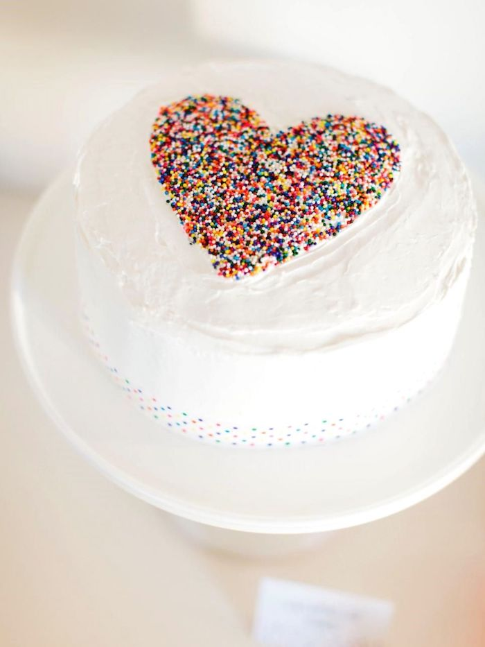 The simple white cake won a heart with colorful sprinkles