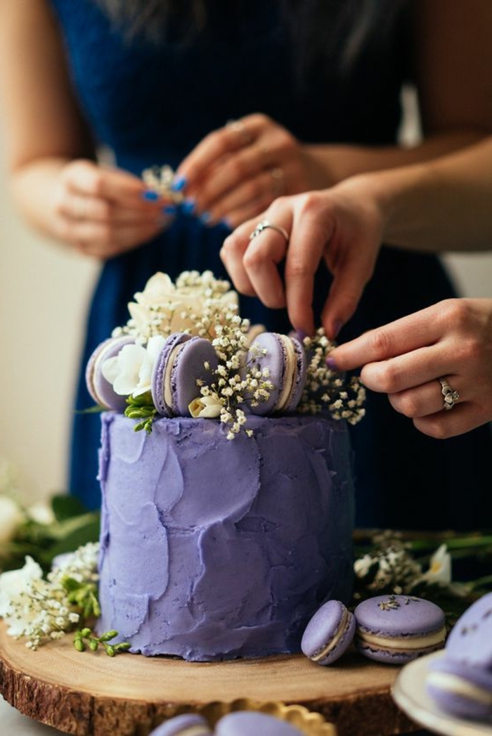 Lilac cake with macarons on top