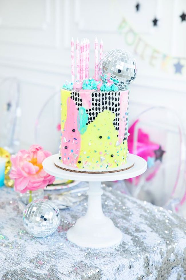 Small cake, with neon accents and mirrored globe