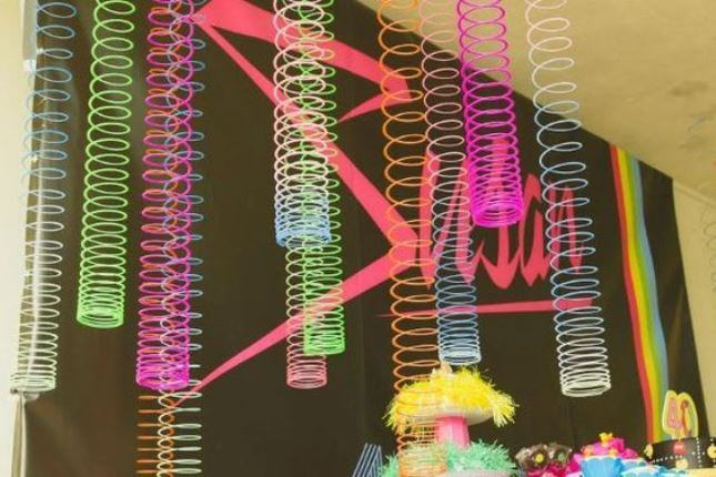 Colorful springs hanging from the ceiling