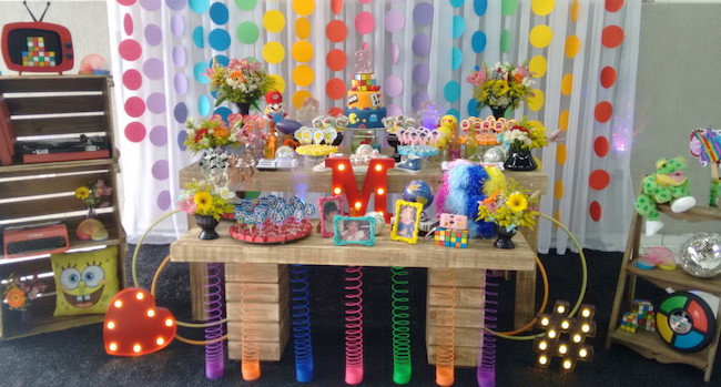 Try using hula hoops and colorful picture frames in the decor