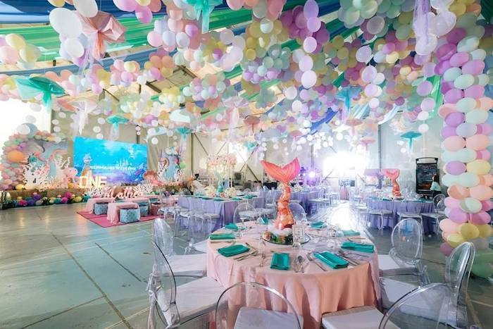 Transparent chairs match the mermaid theme