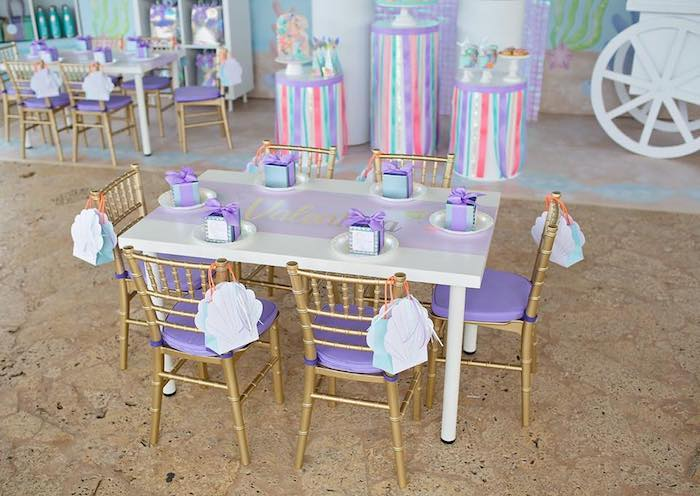 The chairs were painted with gold spray paint to match the theme