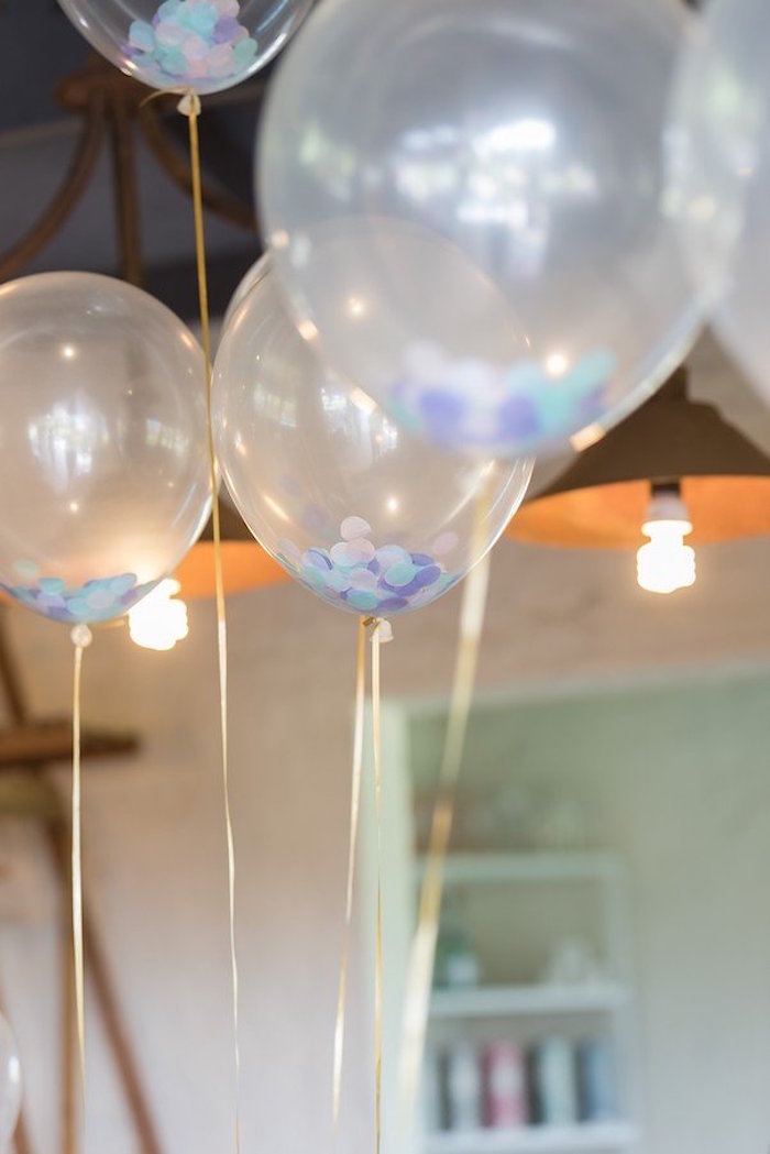 Transparent balloons with colored papers inside