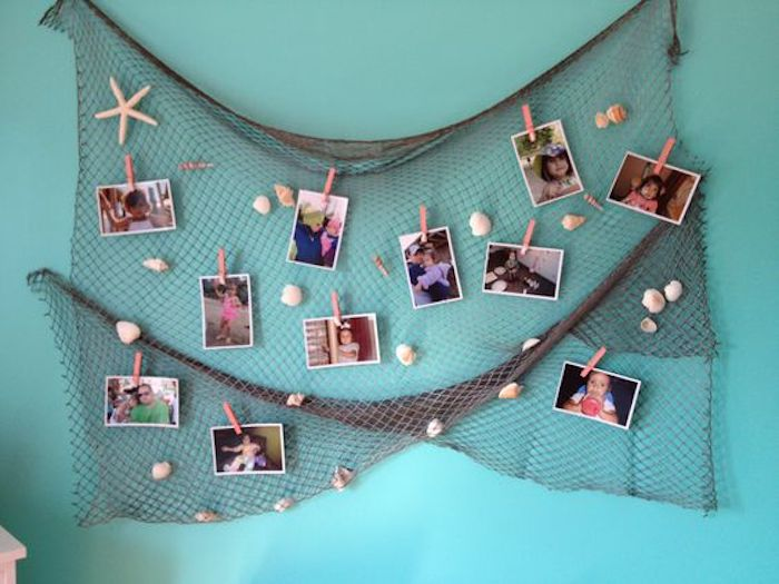 A photo mural of the birthday girl can be mounted with a fishing net