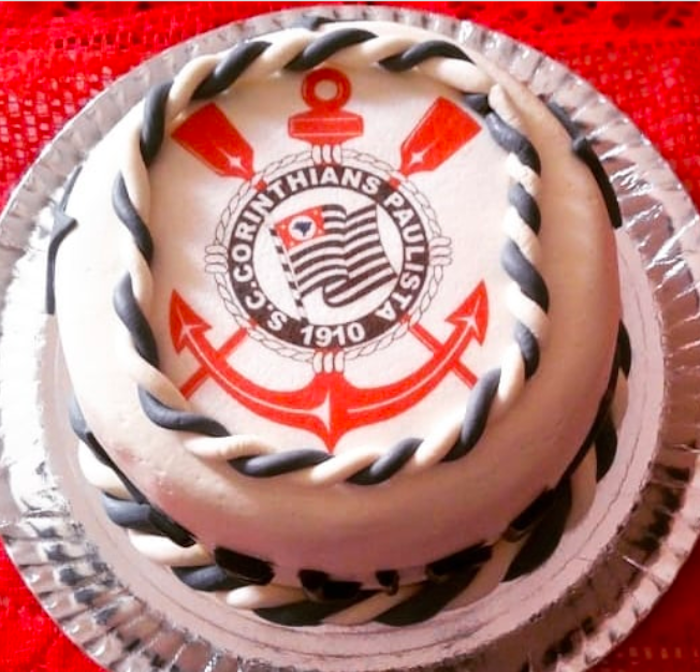 A nest milk cake with the club symbol emblazoned on top.