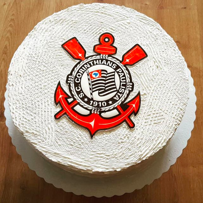 Simple whipped cream cake with club emblem on top