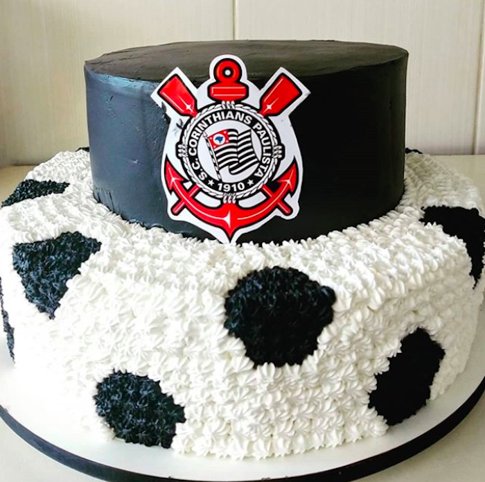 One floor of this cake mimics the appearance of a soccer ball