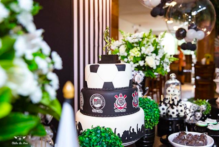 A real trophy decorates the top of this cake